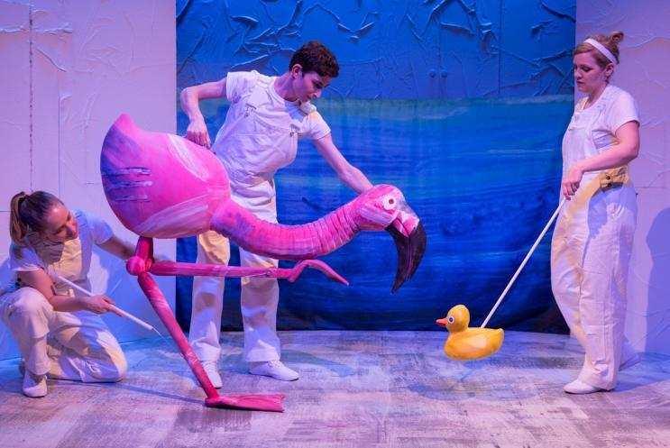 Flamingo and duck puppet and pupperteers